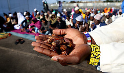SOUTH AFRICA - Cape Town - 25 May 2020 - Refugee Muslim man holds a handfull of Dates to break his fast with according to the teachings of the Prophet Mohammad as they celebrate Eid. The refugee community in Bellville has Muslims from various different African countries celebrate Eid together. Eid marks the end of a month of fasting from sunrise to sunset as well as spiritual reflection and prayer.  Picture:Brendan Magaar/African News Agency (ANA)