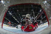 KELOWNA, CANADA - JANUARY 21: Matthew Quigley #5 of the Portland Winterhawks collides with Michael Herringer #30 of the Kelowna Rockets on January 21, 2017 at Prospera Place in Kelowna, British Columbia, Canada.  (Photo by Marissa Baecker/Shoot the Breeze)  *** Local Caption ***
