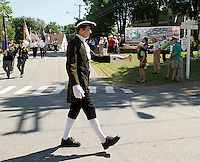 "Geoff Ruggles rings the ""Town Crier"" bell during the Gilford Bicentennial parade Saturday morning.   (Karen Bobotas/for the Laconia Daily Sun)"