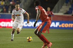 March 1, 2018 - Harrison, New Jersey, United States - New York Red Bulls midfielder SEAN DAVIS (27) dribbles the ball upfield during the CONCACAF Champions league match at Red Bull Arena in Harrison, NJ.  NY Red Bulls defeat CD Olimpia 2-0  (Credit Image: © Mark Smith via ZUMA Wire)