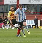 Dundee's Paul McGowan goes past Partick Thistle's Steven Lawless - Dundee v Partick Thistle, SPFL Premiership at Dens Park<br /> <br />  - &copy; David Young - www.davidyoungphoto.co.uk - email: davidyoungphoto@gmail.com