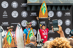 Mateus Herdy of Brazil finishes in the runner-up position and is accepting his trophy for the Hawaiian Pro at Haleiwa, Oahu, Hawaii, USA.