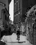 Picture by Andrew Tobin/Tobinators Ltd +44 7710 761829<br /> 04/08/2013<br /> A rider makes his way down a narrow street during the Cycle Messenger World Championships held in Lausanne, Switzerland. Started in 1993 by Achim Beier from Berlin, the championships are not only a sporting contest but an opportunity to unite friends and bicycle enthusiasts worldwide. The event comprises a number of challenges including a sprint, a track stand (longest time stationary on the bike), a cargo race where heavy loads are carried on special bikes, and the main race. The course winds through central Lausanne and includes bridges, stairs, cobbles, narrow alleyways and challenging hills. The main race simulates the job of a bike courier making numerous drops and pickups across the city. Riders need to check in at specific checkpoints, hand over their delivery and get a new one. The main race can take up to 4 hours for each competitor to complete.