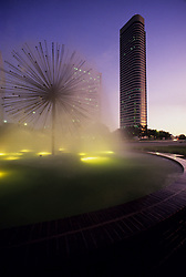 Stock photo of the lights on at the Gus Wotham fountain as night approaches
