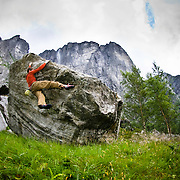 James Bahan climbs on one of the hundreds of granite boulders scattered below Kjerag. Lysefjorden, Norway.