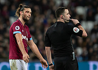 Football - 2018 / 2019 Premier League - West Ham United vs. Brighton & Hove Albion<br /> <br /> Blood flows from the eye of Andy Carroll (West Ham United) as the Referee Christopher Kavanagh stops play at the London Stadium<br /> <br /> COLORSPORT/DANIEL BEARHAM