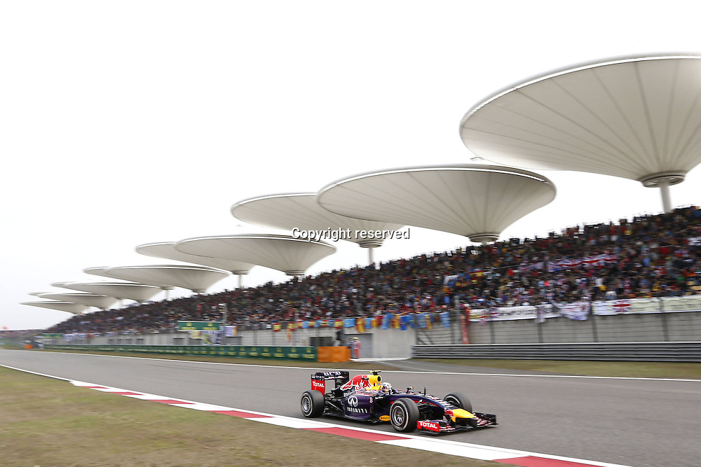 20.04.2014. SHanghai, China.  Motorsports: FIA Formula One World Championship 2014, Grand Prix of China, 3 Daniel Ricciardo (AUS, Infiniti Red Bull Racing) 4th behind winner Hamilton