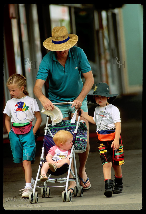 Dad takes kids for walk & puts hat on son in stroller--UV danger in Australia is worsening; Wagga Australia