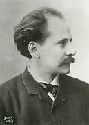 Jules Massenet (1842-1912) at the piano.  French composer best remembered for his operas.