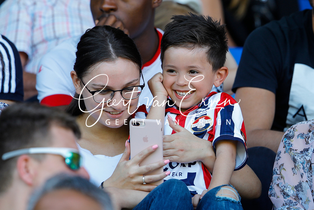Young Supporterof Willem II with his mother