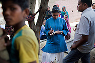 Journalist Suryatapa Bhattacharya reports in remote Lodha Basti, Manana village, Samalkha town, Haryana, India on 15th June 2012.  Photo by Suzanne Lee for The National
