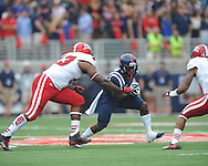 Mississippi Rebels wide receiver Vince Sanders (10) vs. Louisiana-Lafayette Ragin Cajuns cornerback Sean Thomas (24) at Vaught-Hemingway Stadium in Oxford, Miss. on Saturday, September 13, 2014. Ole Miss won 56-15 to improve to 3-0.