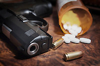 Beretta 9mm PX4 Storm semi-automatic pistol on bedside nightstand with  prescription medication