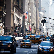 Manhatten street with yellow taxi cabs, New York