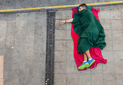 Aman sleeps on the pavement outisde the Budapest rail station. Mostly Syrian refugees seek rest while waiting for trains to take them away to destinations around Europe. The Hungarian government closed the station and then reopened but cancelled all international trains. Budapest Keleti railway station  is the main international and inter-city railway terminal in Budapest, Hungary.