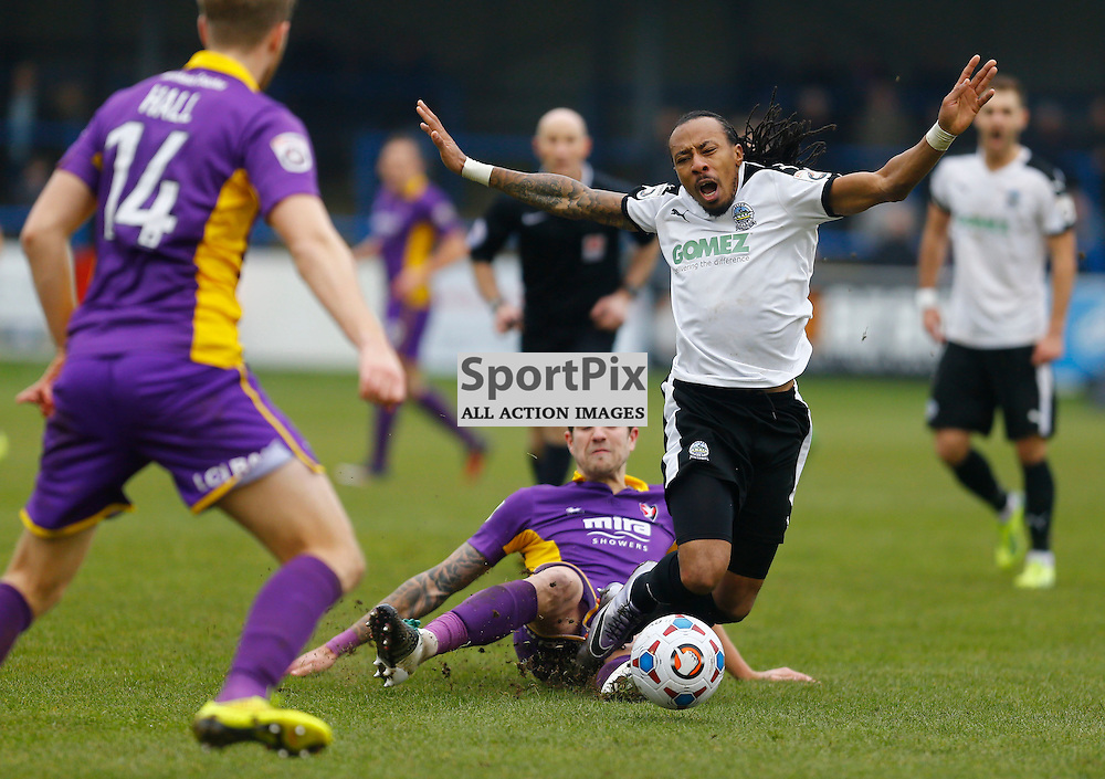 Dover's winger Ricky Modests (7) is tackled by Cheltenham's Harry Pell (7). Dover Athletic v Cheltenham. Vanarama National League. 24th  January 2016. (c) Matt Bristow | SportPix.org.uk