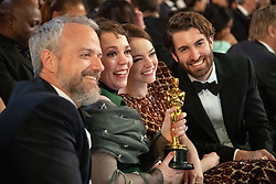 Ed Sinclair, Olivia Colman, Emma Stone and Dave McCary pose with the Oscar® for performance by an actress in a leading role during the live ABC Telecast of The 91st Oscars® at the Dolby® Theatre in Hollywood, CA on Sunday, February 24, 2019.