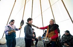 Prime Minister Justin Trudeau receives a water cleansing by spiritual leader Cecil Grinder along with Chiefs of the Tsilhqot'in National Government near Chilko Lake, B.C.,Friday, Nov. 2, 2018. The Prime Minister was in the area to apologize to the Tsilhqot'in community for the hangings of six chiefs during the so-called Chilcotin War over 150 years ago. Photo by The Canadian Press /Jonathan Hayward/ABACAPRESS.COM