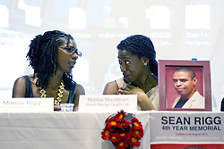 © Licensed to London News Pictures . 21/08/2012 . London , UK . Marcia Rigg (left) , sister of Sean Rigg , who died in police custody in August 2008 , and Matilda MacAttram of Black Mental Health UK on stage at a meeting in Lambeth Town Hall . Video has emerged of a man being detained in Brixton on Sunday ( 19th August ) during which it is alleged police officers stamped on his head . Protesters marched to Brixton Police station and delivered a formal complaint about the incident , following the meeting . Photo credit : Joel Goodman/LNP