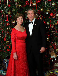 Dec 07, 2003; Washington, D.C., USA; President GEORGE W. BUSH and LAURA BUSH pose for their official Christmas portrait in front of the White House Christmas Tree in the Blue Room, Dec. 7, 2003. This year's holiday theme at the White House celebrates children's storybook characters with, ''A Season of Stories.'' .  (Credit Image: ZUMA Press/ZUMAPRESS.com)