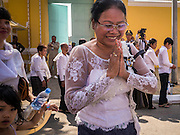 02 FEBRUARY 2013 - PHNOM PENH, CAMBODIA: A woman waits in line to see the crematorium of King Norodom Sihanouk during the mourning period for Sihanouk, who ruled Cambodia from independence in 1953 until he was overthrown by a military coup in 1970. Sihanouk died in Beijing, China, in October 2012.      PHOTO BY JACK KURTZ