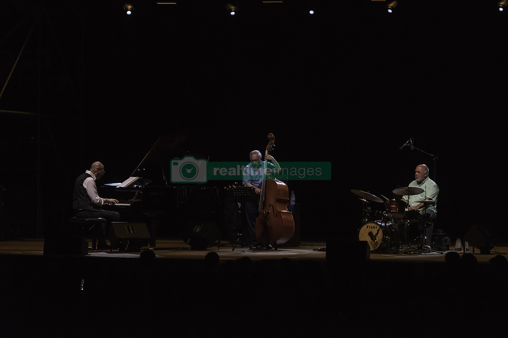 July 21, 2019 - Rome, Italy, Italy - The Trio composed by Peter Erskine on the drums, Eddie Gomez on the double bass and Dado Moroni on the piano, performed on 21/7/2019 on the stage of the Casa del Jazz in Rome during the Summertime 2019 festival. Dado Moroni (L), Eddie Gomez and Peter Erskine  (Credit Image: © Leo Claudio De Petris/Pacific Press via ZUMA Wire)