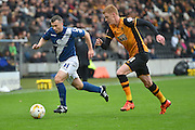 Paul Caddis of Birmingham city  and Hull City midfielder Sam Clucas during the Sky Bet Championship match between Hull City and Birmingham City at the KC Stadium, Kingston upon Hull, England on 24 October 2015. Photo by Ian Lyall.