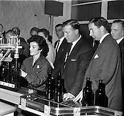 26/09/1962<br /> 09/26/1962<br /> 26 September 1962<br /> Opening of Earl Bottlers Ltd. at South Earl Street, Dublin. Minister for Justice Charles Haughey opened the new premises. Mr Haughey (centre) inspecting the new plant after the opening accompanied by Mr W. Campbell, Director of Earl Bottlers. Miss Ann Moran of Dublin is operating the filling machine.