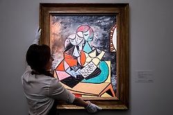 "© Licensed to London News Pictures. 19/06/2015. London, UK. A Sotheby's staff member shows Pablo Picasso's ""Deux Personnages (La Lecture)"" (est. £13m - £18m), at Sotheby's Impressionist, Modern & Contemporary Art preview, ahead of the sale on 24 June 2015. Leading the sale are Kazimir Malevich's, ""Suprematism, 18th Construction"" and Edouard Manet's ""Le Bar aux Folies-Bergère"".  Photo credit : Stephen Chung/LNP"