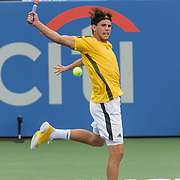 DOMINIC THIEM hits a backhand during his match on day four at the Citi Open at the Rock Creek Park Tennis Center in Washington, D.C.