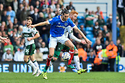 Portsmouth Defender, Christian Burgess (6) beats Plymouth Argyle Forward, Ryan Taylor (19) to the ball during the EFL Sky Bet League 2 match between Portsmouth and Plymouth Argyle at Fratton Park, Portsmouth, England on 14 April 2017. Photo by Adam Rivers.