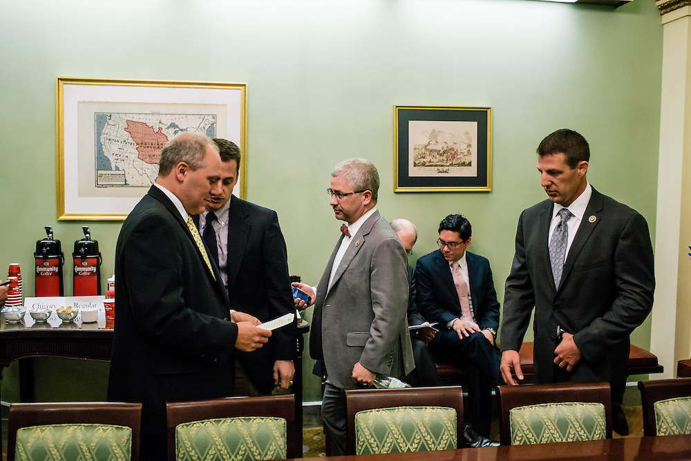 U.S. Rep. Patrick McHenry (R-N.C.), the chief deputy whip of House Republicans, talks with fellow republicans, including Majority Whip Steve Scalise, left, at a weekly deputy whip meeting at the U.S. Capitol on April 23, 2015. McHenry is considered one of the fastest-rising stars of House Republicans.