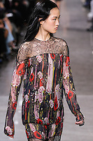 Jing Wen walks the runway wearing Jason Wu Fall 2016, Hair by Paul Hanlon for Morocconoil, Makeup by Yadim for Maybelline, shot by Thomas Concordia during New York Fashion Week on February 12, 2016