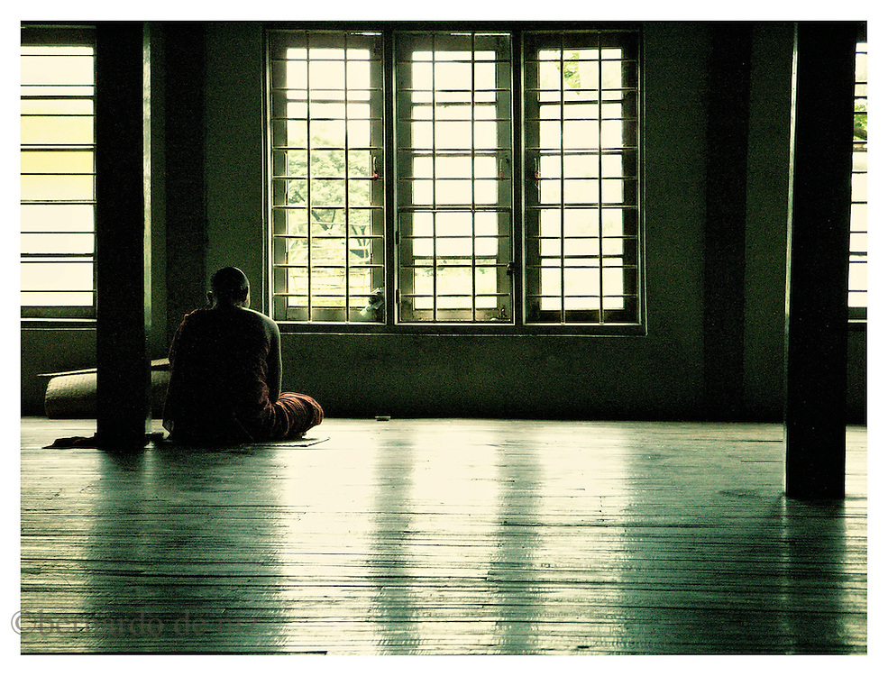 A young monk prays inside of one of the old and small monasteries that are scattered in the countryside of Burma, where many monks have gone into hiding. Many monks in their twenties are now the target of the persecution and repression of the military dictatorship in Burma. Monday October 8, 2007. Delta Region, Myanmar (Burma)/