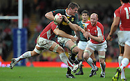 Photo © TOM DWYER / SECONDS LEFT IMAGES 2010 - Rugby Union - Invesco Perpetual Series - Wales v South Africa - 13/11/10 - Wales' Bradley Davies tackles   Bakkies Botha - at Millennium Stadium Cardiff Wales UK -  All rights reserved