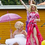 NLD/Amsterdam/20100807 - Boten tijdens de Canal Parade 2010 door de Amsterdamse grachten. De jaarlijkse boottocht sluit traditiegetrouw de Gay Pride af. Thema van de botenparade was dit jaar Celebrate,
