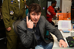 © Licensed to London News Pictures. 27/10/2016. Musician JAMES BLUNT takes part in trading at Bloomberg, encouraging stockbrokers and companies to make donations to their chosen charities. London, UK. Photo credit: Ray Tang/LNP
