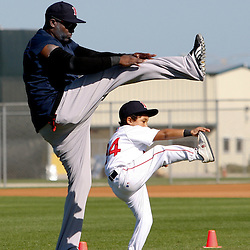 February 19, 2011; Fort Myers, FL, USA; Boston Red Sox first baseman David Ortiz and son D'Angelo Ortiz stretch during spring training practice at the Player Development Complex.  Mandatory Credit: Derick E. Hingle