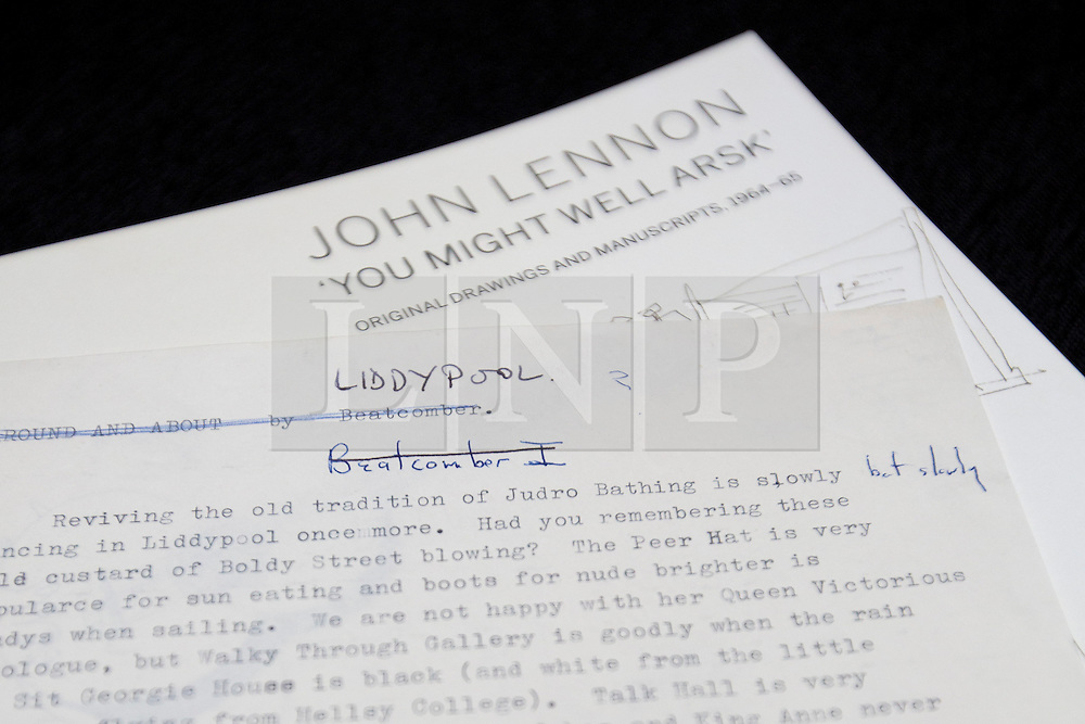 "© Licensed to London News Pictures. 21/03/2014. London, UK. ""Liddypool"" (est. GB£7,200-9,000) a sartorial guide to Liverpool typed by the late Beetles singer John Lennon, is seen during the press view for a new sale at Sotheby's auction house in London today (21/03/2014). The auction, entitled ""You Might Well Arsk"", features original drawings and manuscripts by the singer from 1964-1965. Photo credit: Matt Cetti-Roberts/LNP"