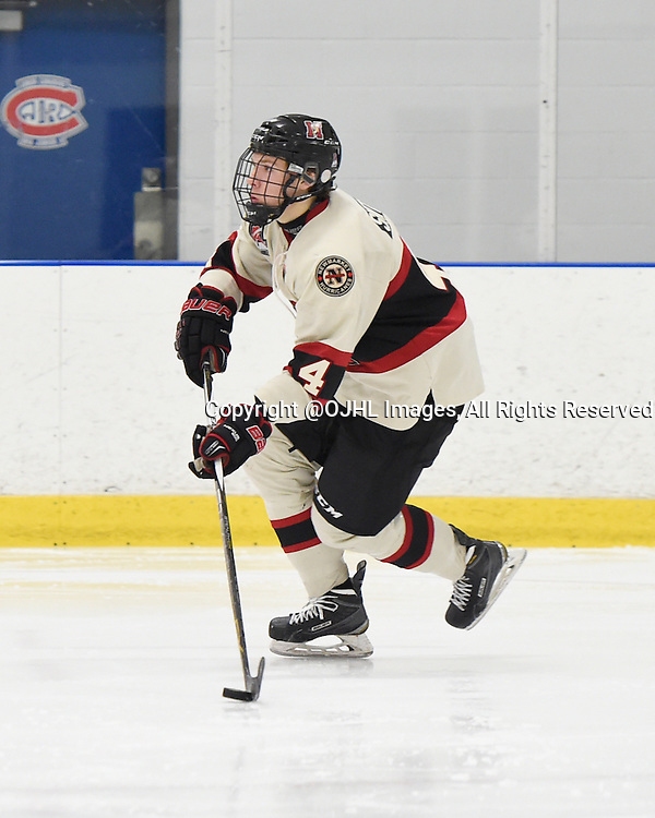 TORONTO, ON - Oct 17, 2015 : Ontario Junior Hockey League game action between Newmarket and Toronto, Adam Smith #4 of the Newmarket Hurricanes skates with the puck during the third period.<br /> (Photo by Andy Corneau / OJHL Images)