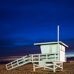 Lifeguard tower 1550 at night at Santa Monica Beach in Southern California. Photo is vertical and high resolution. Copyright ⓒ 2017 Paul Velgos with All Rights Reserved.