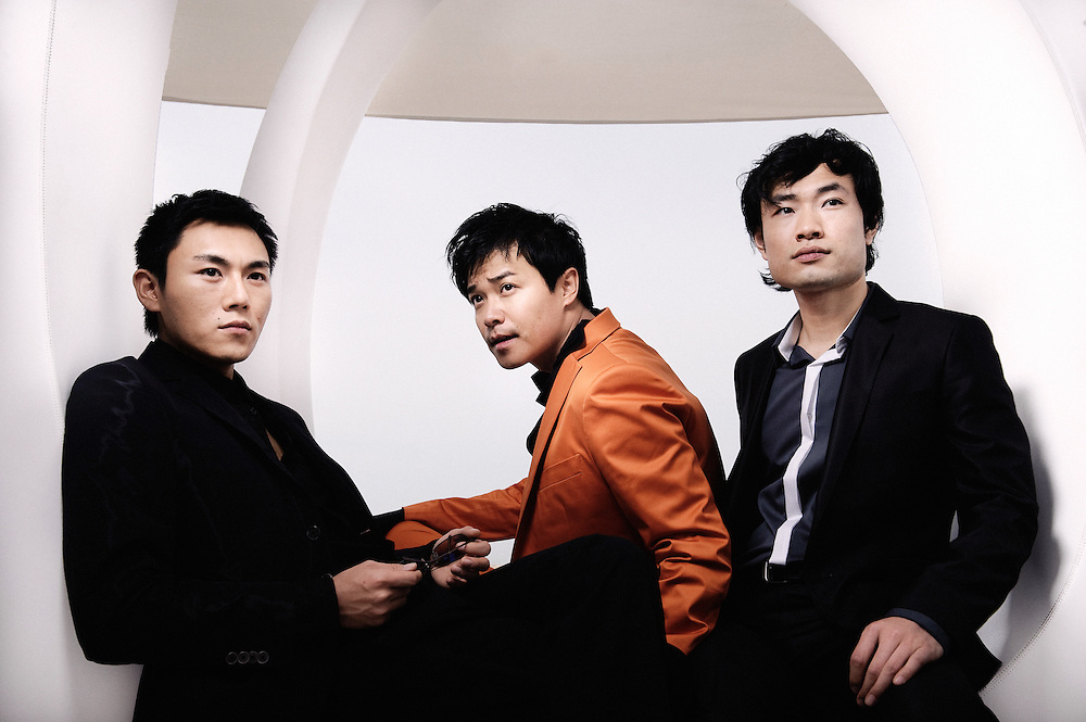 Spring Fever's actors, from left to right: Qin Hao, Chen Sicheng, and Wu Wei at the Martini Terrasse during the Cannes Film Festival. France. 14 May 2009. Photo: Antoine Doyen