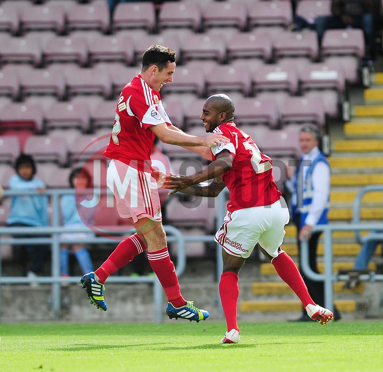 Bristol City's Marvin Elliott celebrates his goal with Bristol City's Greg Cunningham   - Photo mandatory by-line: Dougie Allward/JMP - Tel: Mobile: 07966 386802 11/08/2013 - SPORT - FOOTBALL - Sixfields Stadium - Sixfields Stadium -  Coventry V Bristol City - Sky Bet League One