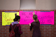 STARKVILLE, MS – FEBRUARY 1, 2017: Gail Moraru (left) and Katie Graham (right) post signs at a vigil honoring international students and in rejection of the travel ban at Mississippi State University. CREDIT: Bob Miller for The New York Times