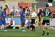 AFC Wimbledon defender Deji Oshilaja (4) yellow card during the EFL Sky Bet League 1 match between AFC Wimbledon and Doncaster Rovers at the Cherry Red Records Stadium, Kingston, England on 26 August 2017. Photo by Matthew Redman.