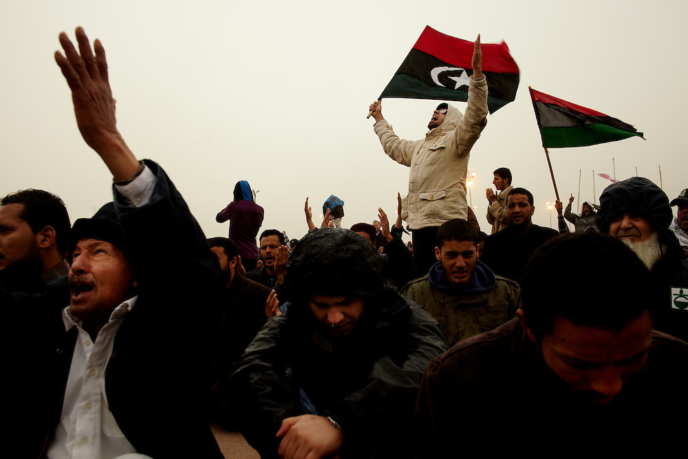 Benghazi, Libya, 04.03.11..Cheering in the center of Benghazi where tens of thousands have gathered to do outdoor prayer.. .Photo by: Eivind H. Natvig/MOMENT