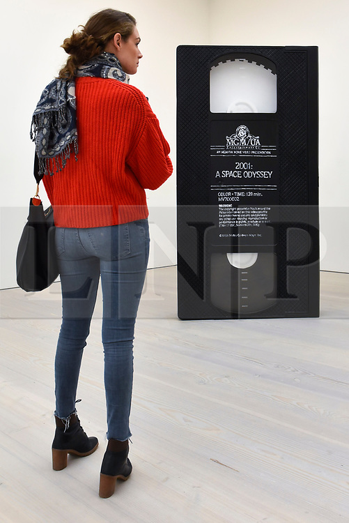 """© Licensed to London News Pictures. 27/09/2018. LONDON, UK. A visitor views """"VHS"""", 2005, by David Herbert.  Preview of """"Black Mirror"""", a major new exhibition featuring the work of 26 contemporary artists, at the Saatchi Gallery.  The show explores art's role in social satire and how political uncertainty has influenced art of recent years and runs 28 September to 13 January 2019.   Photo credit: Stephen Chung/LNP"""