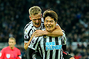 Ki Sung-Yueng (#4) of Newcastle United and Mohamed Diame (#10) of Newcastle United celebrate Newcastle United's first goal (1-0) scored by Ayoze Perez (#17) of Newcastle United and assisted by Ki Sung-Yueng (#4) of Newcastle United during the Premier League match between Newcastle United and Watford at St. James's Park, Newcastle, England on 3 November 2018.