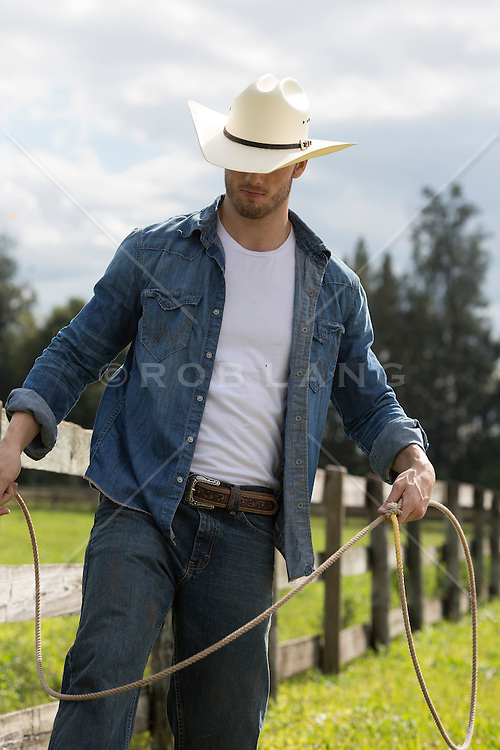 cowboy with a lasso on a ranch outdoors