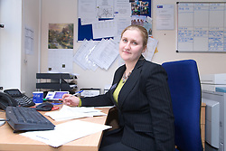 Polish office worker sitting at desk,
